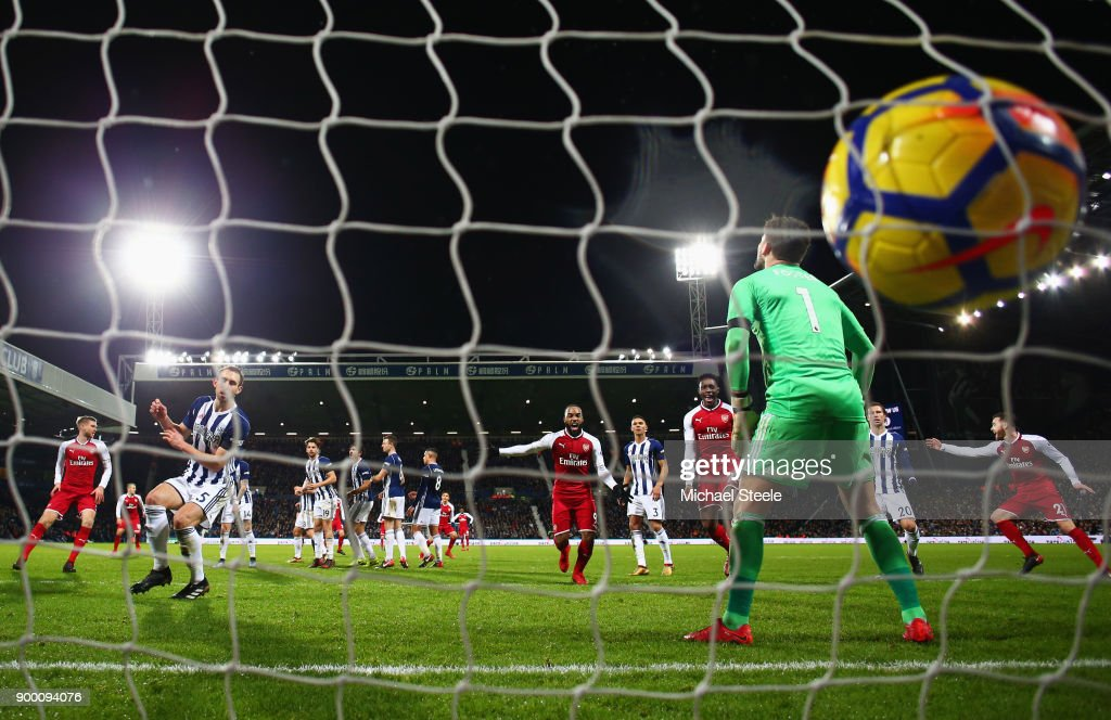 Ben Foster of West Bromwich Albion fails to stop a free kick by Alexis Sanchez of Arsenal which deflects off James McClean of West Bromwich Albion for their first goal during the Premier League match between West Bromwich Albion and Arsenal at The Hawthorns on December 31, 2017 in West Bromwich, England.