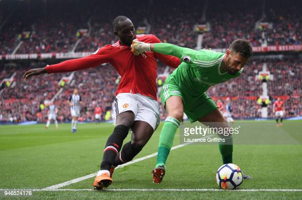 Ben Foster of West Bromwich Albion is challenged by Romelu Lukaku of Manchester United during the Premier League match between Manchester United and...