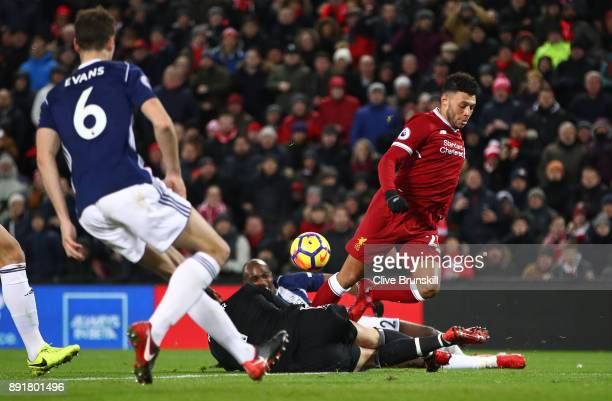 Ben Foster of West Bromwich Albion makes a save Alex OxladeChamberlain of Liverpool during the Premier League match between Liverpool and West...