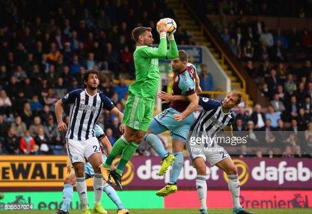 Ben Foster of West Bromwich Albion makes a save from Sam Vokes of Burnley during the Premier League match between Burnley and West Bromwich Albion at...