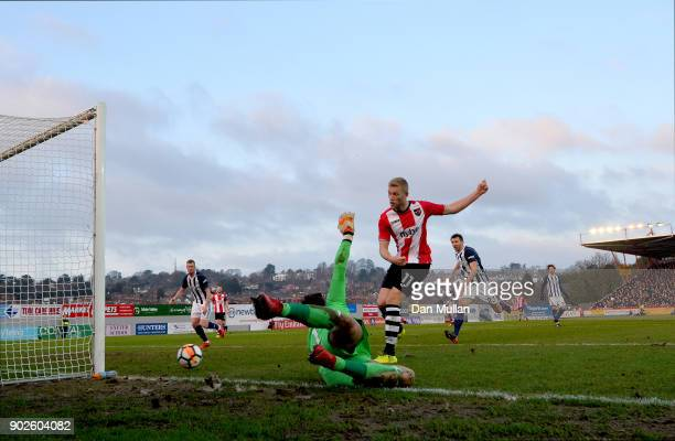 Ben Foster of West Bromwich Albion saves a shot from Jayden Stockley of Exeter City during The Emirates FA Cup Third Round match between Exeter City...