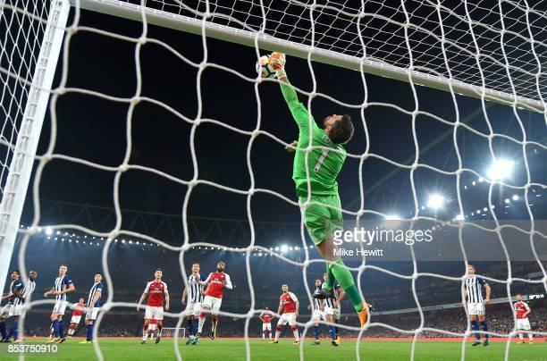 Ben Foster of West Bromwich Albion saves before Alexandre Lacazette of Arsenal follows up to score their first goal during the Premier League match...
