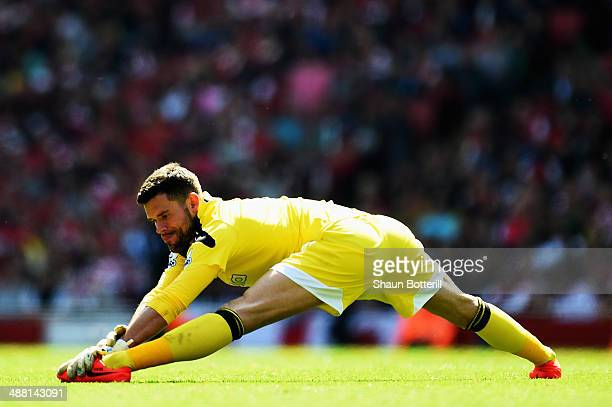 Ben Foster the West Bromwich goalkeeper limbers up during the Barclays Premier League match between Arsenal and West Bromwich Albion at the Emirates...