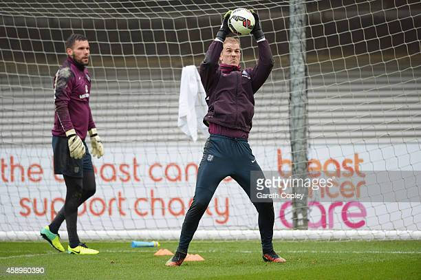 Ben Foster watches fellow goalkeeper Joe Hart in action during an England training session ahead of the UEFA European Championship qualifier match...