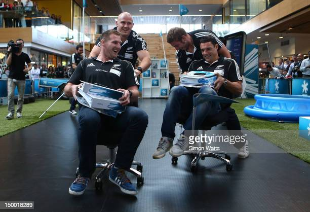 Ben Franks Kieran Read Luke Romano and Dan Carter of the New Zealand All Blacks compete in an office chair race the unveiling of Telecomexclusive...