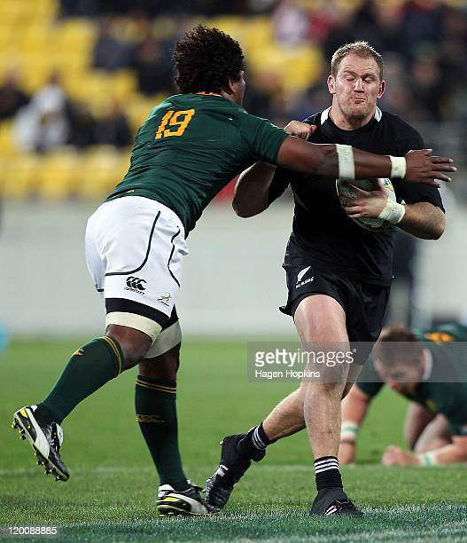 Ben Franks of the All Blacks is tackled by Ashley Johnson of South Africa during the TriNations match between the New Zealand All Blacks and the...