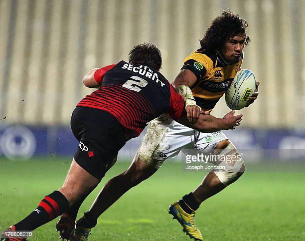 Ben Funnell of Canterbury tackles Isaia Tuifua of Taranaki during the round 1 ITM Cup match between Cantebury and Taranaki at AMI Stadium on August...