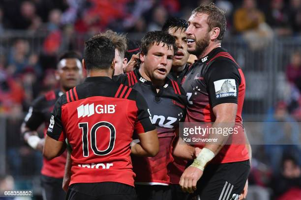 Ben Funnell of the Crusaders is congratulated by team mates after scoring a try during the round eight Super Rugby match between the Crusaders and...