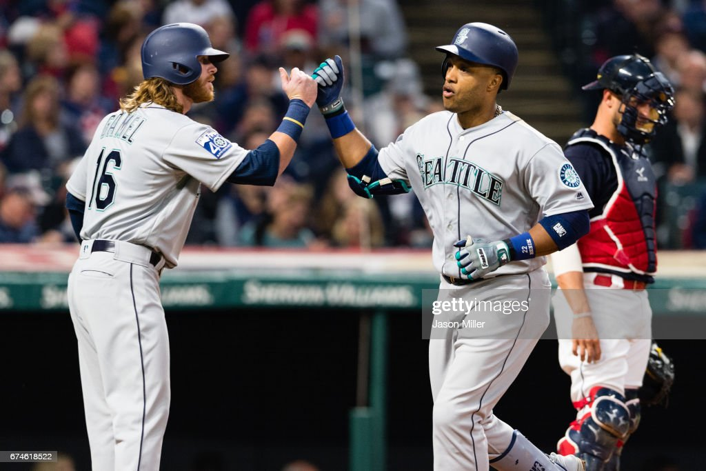 Ben Gamel #16 celebrates with Robinson Cano #22 of the Seattle Mariners after both scored on a two run home run by Cano during the fourth inning against the Cleveland Indians at Progressive Field on April 28, 2017 in Cleveland, Ohio.