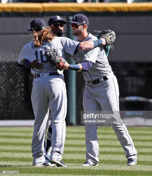 Ben Gamel Dee Gordon and Mitch Haniger of the Seattle Mariners celebrate a win over the Chicago White Sox at Guaranteed Rate Field on April 25 2018...