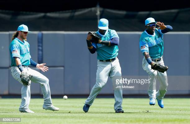 Ben Gamel Jean Segura and Guillermo Heredia of the Seattle Mariners can't come up with a ball hit by Gary Sanchez of the New York Yankees during the...