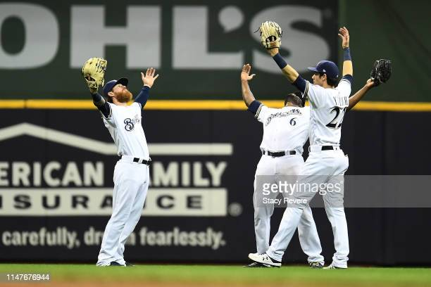 Ben Gamel, Lorenzo Cain and Christian Yelich of the Milwaukee Brewers celebrate a victory over the Washington Nationals at Miller Park on May 07,...