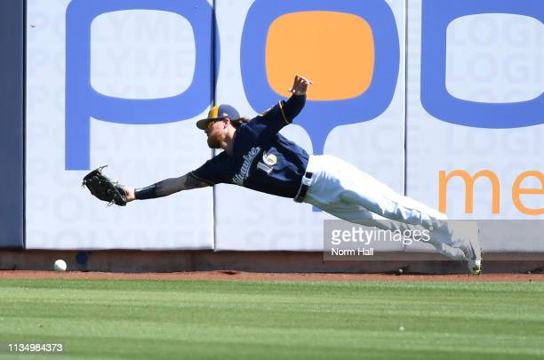 Ben Gamel of the Milwaukee Brewers cannot make a diving catch against the Chicago Cubs during the third inning a spring training game at Maryvale...