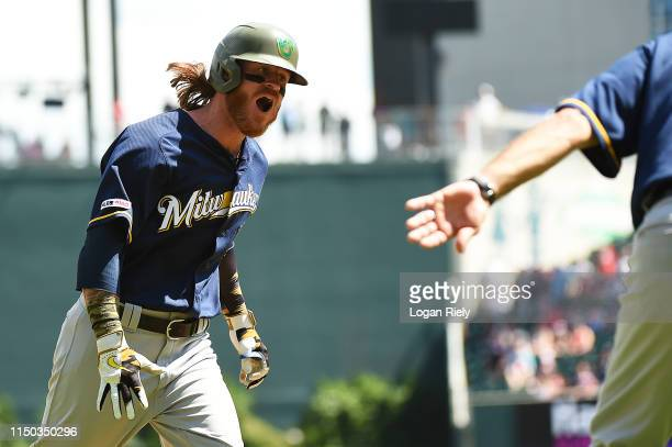 Ben Gamel of the Milwaukee Brewers celebrates after hitting the game winning home run in the 10th inning against the at SunTrust Park on May 19 2019...
