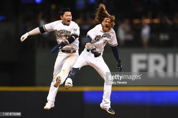 Ben Gamel of the Milwaukee Brewers celebrates with Keston Hiura after hitting the game winning RBI against the San Francisco Giants during the ninth...