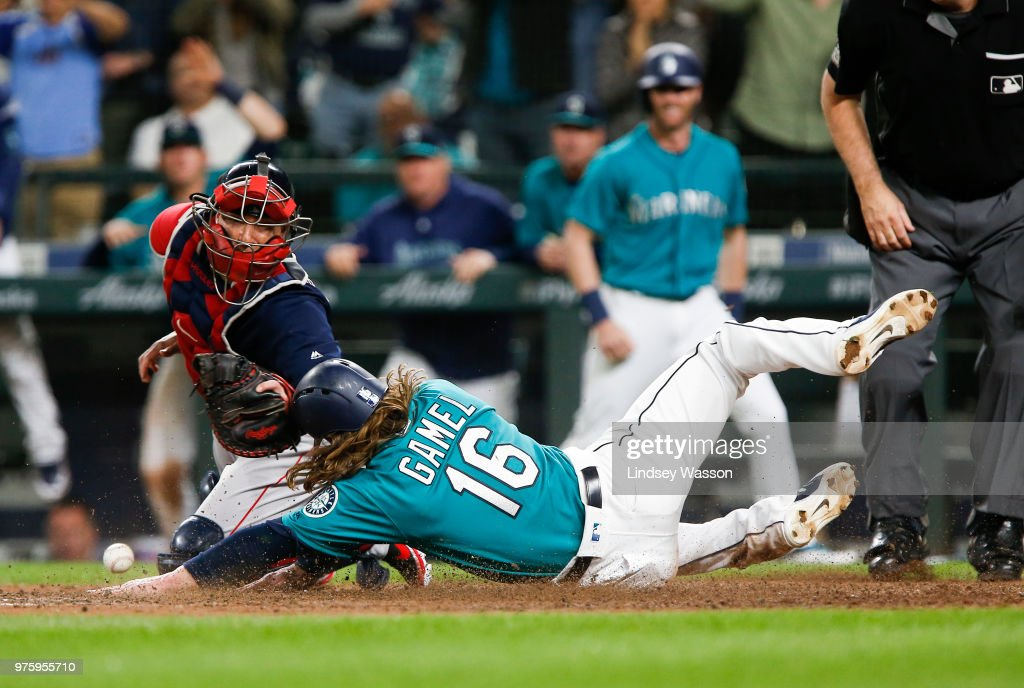 Ben Gamel #16 of the Seattle Mariners beats the throw to Christian Vazquez #7 of the Boston Red Sox at home to score the winning run in the eighth inning of the game at Safeco Field on June 15, 2018 in Seattle, Washington.