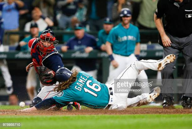 Ben Gamel of the Seattle Mariners beats the throw to Christian Vazquez of the Boston Red Sox at home to score the winning run in the eighth inning of...