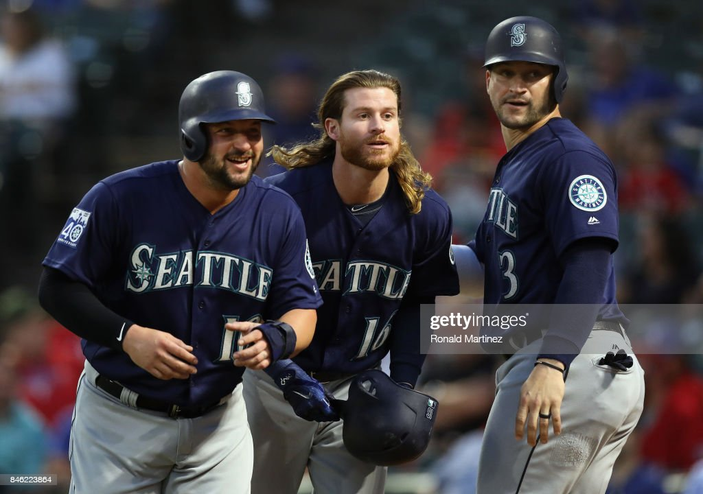 Ben Gamel #16 of the Seattle Mariners, center celebrates a three-run home run with Yonder Alonso #10, left and Mike Zunino #3 in the second inning against the Texas Rangers at Globe Life Park in Arlington on September 12, 2017 in Arlington, Texas.
