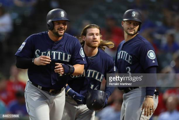 Ben Gamel of the Seattle Mariners center celebrates a threerun home run with Yonder Alonso left and Mike Zunino in the second inning against the...