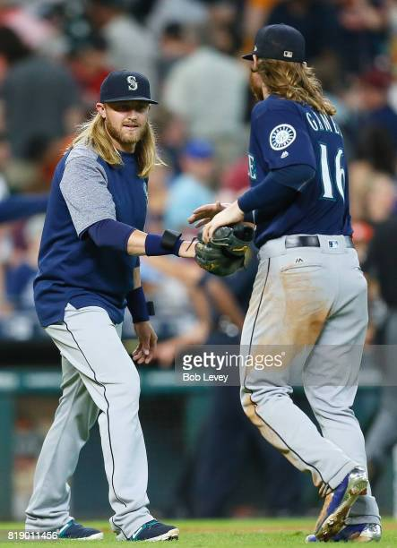 Ben Gamel of the Seattle Mariners shakes hands with Taylor Motter after the final out against the Houston Astros at Minute Maid Park on July 19 2017...