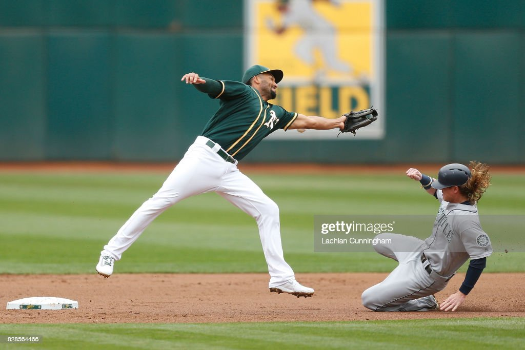Ben Gamel #16 of the Seattle Mariners steals second base as Marcus Semien #10 of the Oakland Athletics fils to catch a ball thrown by catcher Bruce Maxwell #13 during the first inning at Oakland Alameda Coliseum on August 9, 2017 in Oakland, California.