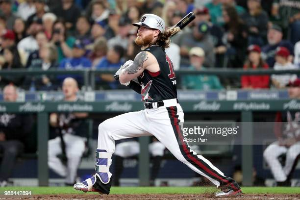 Ben Gamel of the Seattle Mariners watches his hit in the third inning against the Kansas City Royals during their game at Safeco Field on June 30...