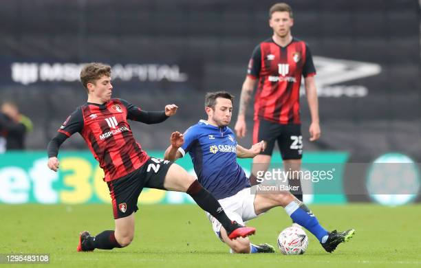 Ben Garrity of Oldham Athletic is challenged by Gavin Kilkenny of AFC Bournemouth during the FA Cup Third Round match between Oldham Athletic and AFC...