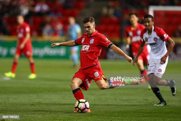 Ben Garuccio of Adelaide crosses the ballduring the round 27 ALeague match between Adelaide United and the Western Sydney Wanderers at Coopers...