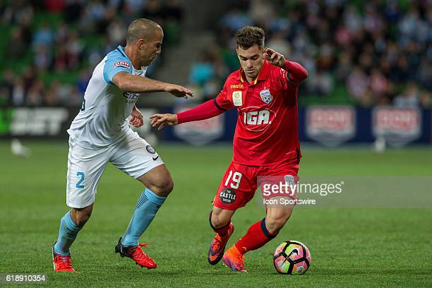 Ben Garuccio of Adelaide United and Manny Muscat of Melbourne City contest the ball during the 4th round of the Hyundai ALeague between Melbourne...