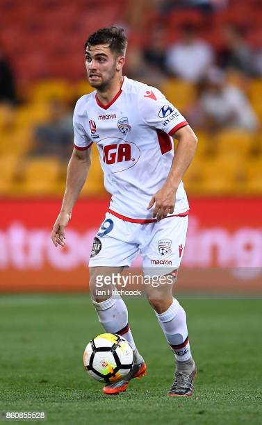 Ben Garuccio of Adelaide United dribbles the ball during the round two ALeague match between the Brisbane Roar and Adelaide United at Suncorp Stadium...