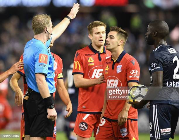 Ben Garuccio of Adelaide United is sent off the field after getting a red card during the round 10 ALeague match between the Melbourne Victory and...
