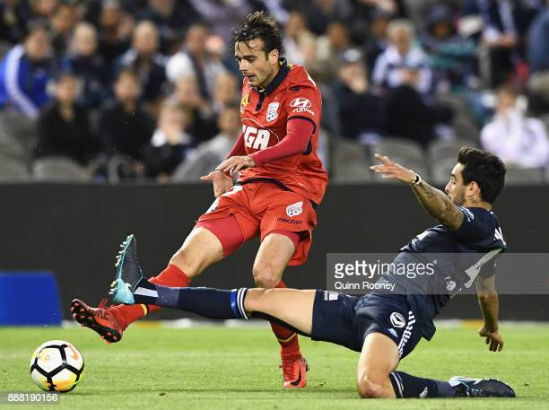 Ben Garuccio of Adelaide United passes the ball during the round 10 ALeague match between the Melbourne Victory and Adelaide United at Etihad Stadium...