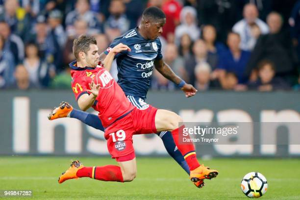 Ben Garuccio of Adelaide United tackles Leroy George of the Victory during the ALeague Elimination Final match between Melbourne Victory and Adelaide...