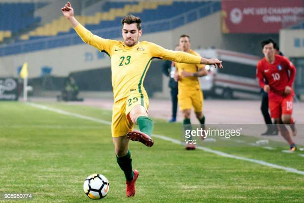 Ben Garuccio of Australia kicks the ball during the AFC U23 Championship Group D match between South Korea and Australia at Kunshan Sports Centre...
