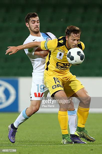 Ben Garuccio of Melbourne and Chris Harold of the Glory contest for the ball during the FFA Cup Semi Final match between Perth Glory and Melbourne...
