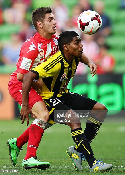 Ben Garuccio of the Heart competes with Roy Krishna of the Phoenix during the round 23 ALeague match between Melbourne Heart and the Wellington...