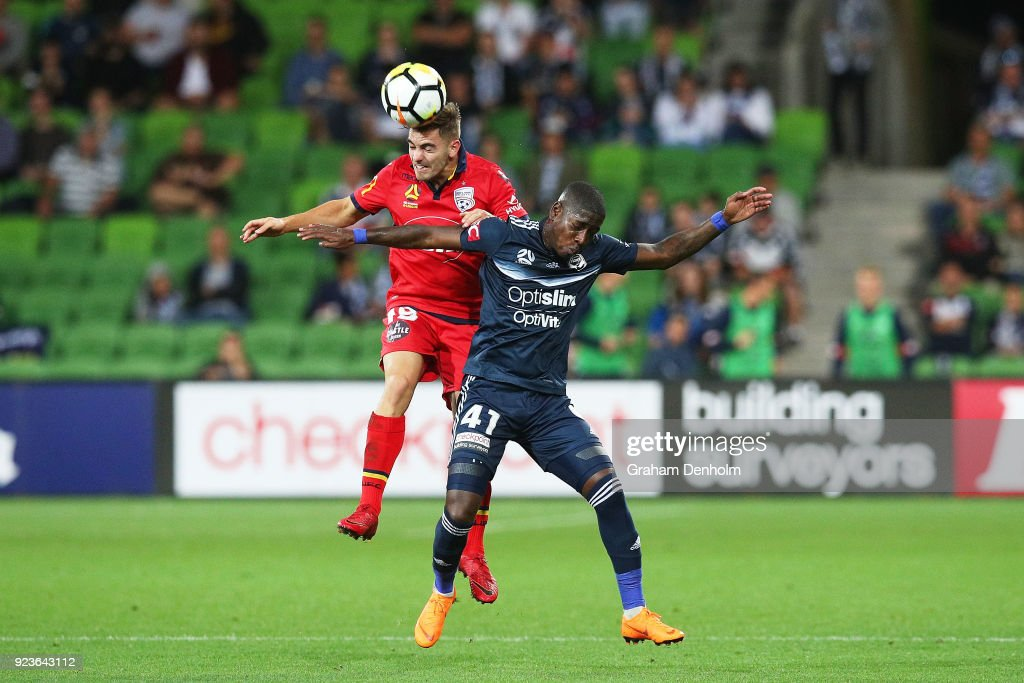 Ben Garuccio of United (L) and Leroy George of the Victory compete for the ball during the round 21 A-League match between the Melbourne Victory and Adelaide United at AAMI Park on February 24, 2018 in Melbourne, Australia.