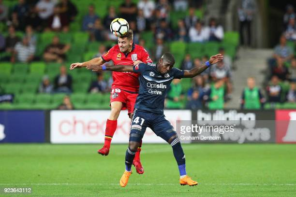 Ben Garuccio of United and Leroy George of the Victory compete for the ball during the round 21 ALeague match between the Melbourne Victory and...
