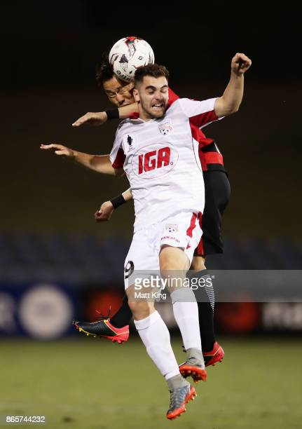 Ben Garuccio of United is challenged by Jumpei Kusukami of the Wanderers during the FFA Cup Semi Final match between the Western Sydney Wanderers and...