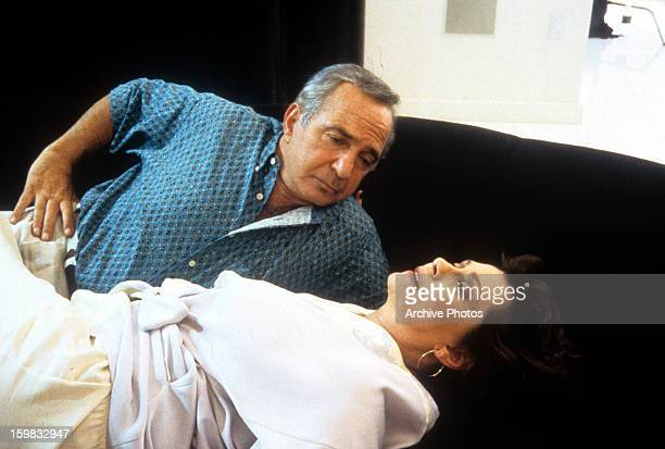 Ben Gazzara lies next to Elizabeth Ashley in a scene from the film 'Happiness', 1998.