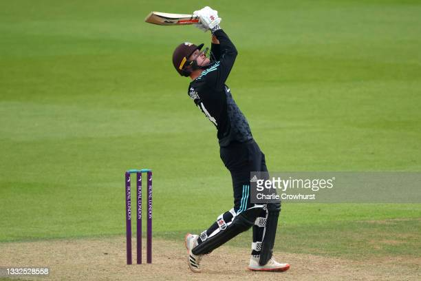 Ben Geddes of Surrey hits out during the Royal London Cup match between Surrey and Somerset at The Kia Oval on August 05, 2021 in London, England.
