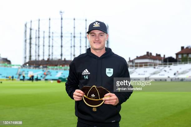 Ben Geddes of Surrey poses for a picture after being presented with his cap during the Vitality T20 Blast match between Surrey and Essex Eagles at...
