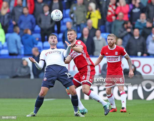 Ben Gibson and Bolton Wanderers' Gary Madine during the Sky Bet Championship match between Bolton Wanderers and Middlesbrough at Macron Stadium on...