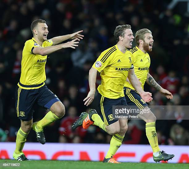 Ben Gibson Grant Leadbitter and Adam Clayton of Middlesbrough celebrate after the Capital One Fourth Round match between Manchester United and...