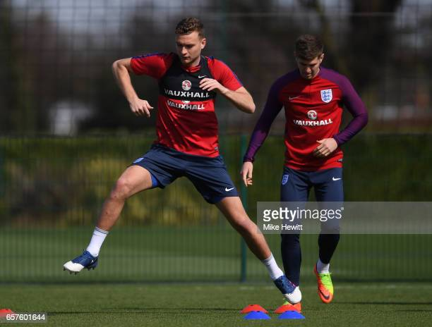 Ben Gibson of England runs through drills with teammates during the England training session at the Tottenham Hotspur Training Centre on March 25...
