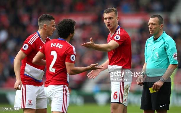 Ben Gibson of Middlesbrough argues with Fabio Da Silva of Middlesbrough during the Premier League match between Middlesbrough and Manchester City at...
