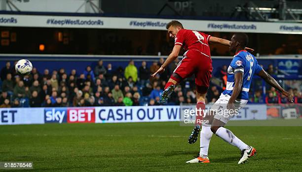 Ben Gibson of Middlesbrough heads his side's third goal during the Sky Bet Championship match between Queens Park Rangers and Middlesbrough at Loftus...