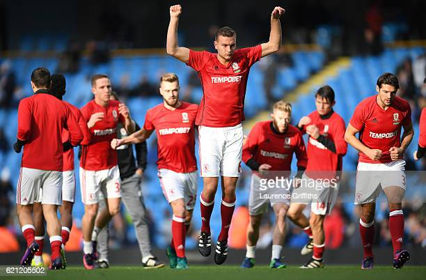 Ben Gibson of Middlesbrough warms up with his Middlesbrough team mates prior to kick off during the Premier League match between Manchester City and...