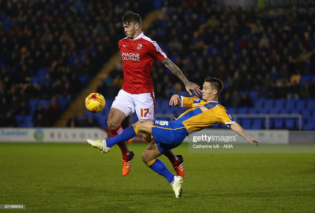 Ben Gladwin of Swindon Town and Ian Black of Shrewsbury Town during the Sky Bet League One match between Shrewsbury Town and Swindon Town at New Meadow on December 19, 2015 in Shrewsbury, United Kingdom.