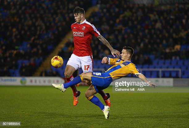 Ben Gladwin of Swindon Town and Ian Black of Shrewsbury Town during the Sky Bet League One match between Shrewsbury Town and Swindon Town at New...